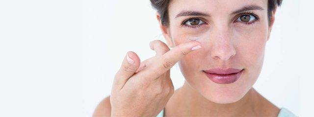 Woman Holding Contact Lens 1280x480 640x240