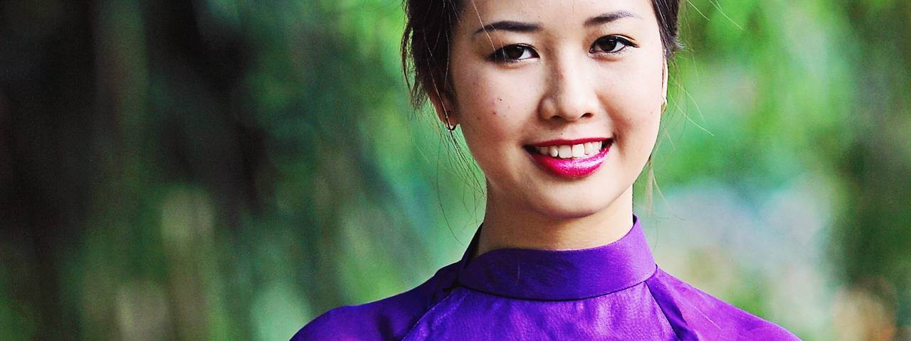 Asian-Canadian Woman Smiling Purple Dress