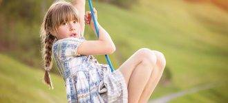 Young girl playing on swing advertising VST (Ortho-K) in Ashburn, VA