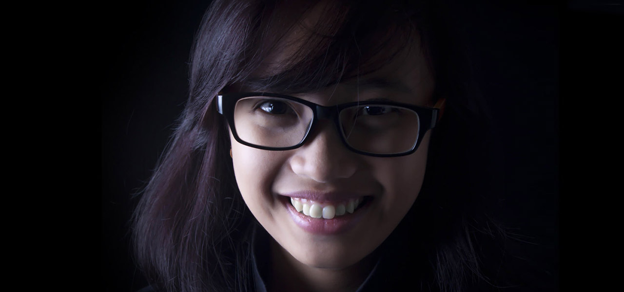 asian-glasses-teen-girl-dark-bg
