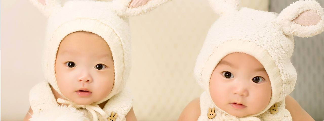 babies dressed as bunnies 1280x480