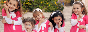 group of girls in pink with lollipops slide 300x109