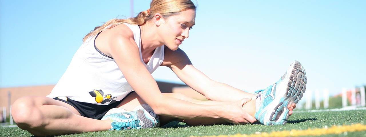 Female Runner Stretching 1280x480