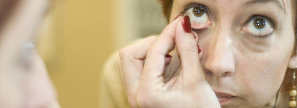 woman removing contact