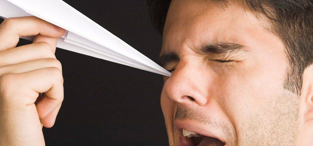 Man Poking Eye with Paper Airplane1280x853 1024x682 1024x480