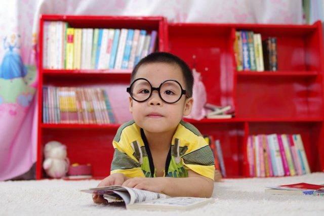 Eye doctor, little asian boy wearing eyeglasses in Bozeman, MT