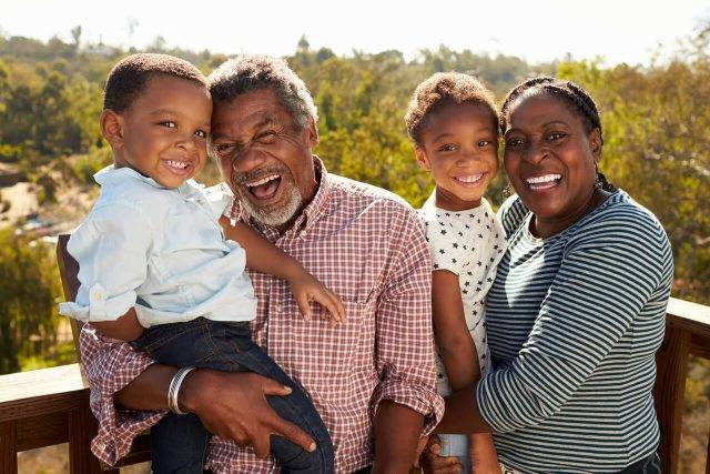 African-American family happy after macular degeneration treatment