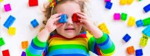 Eye doctor, little girl with pieces of lego on her eyes in Old Bridge, NJ