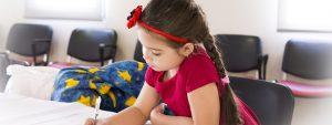 Eye doctor, little girl doing her homework in Old Bridge, NJ