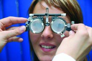 Eye doctor, woman at an eye exam in Waco, TX