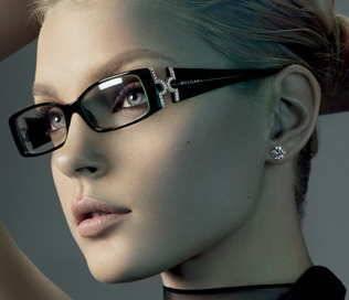 Model wearing designer frames