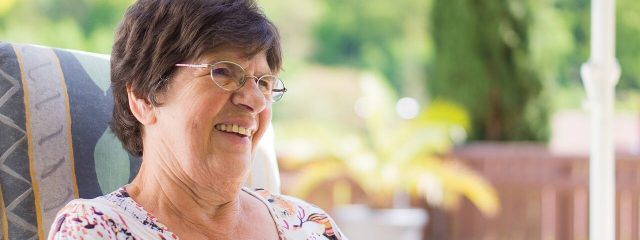 Eye doctor, senior woman smiling in Plainview, NY