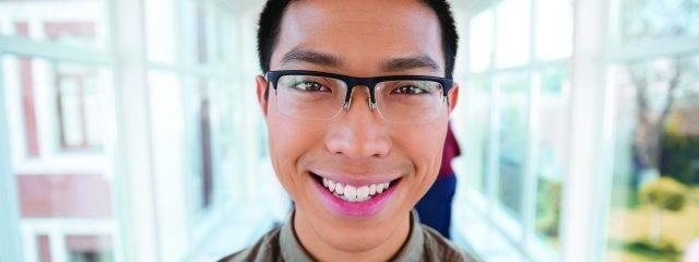 Eye doctor, happy asian teenager wearing eyeglasses in Plainview, NY