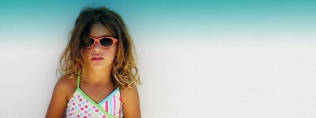 Eye doctor, little girl wearing sunglasses in Austin, TX