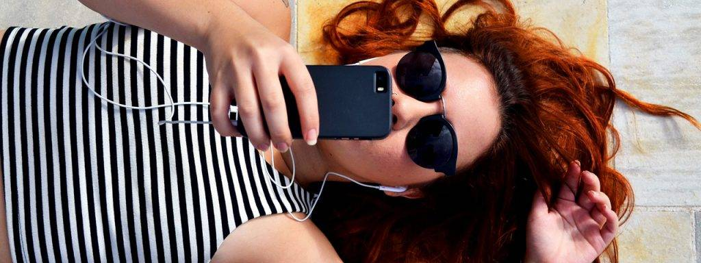 Female-Redhead-Lying-Down-Sunglasses-1280x480-1024x384
