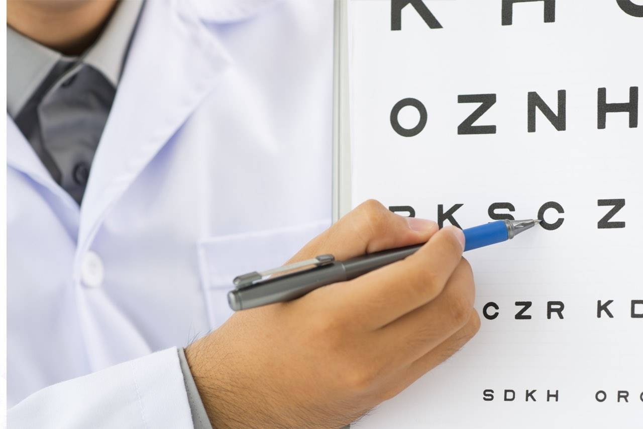 Eye Doctor in South Houston, Pointing to Eye Chart