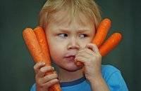 little boy holding carrots in Hopewell, NJ