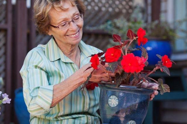 optometrist, senior woman with flowers in Edmonton, Alberta