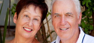 senior couple in white slide 330x150