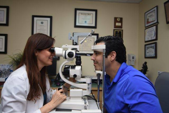 Dr. Laria Giving an Eye Exam at Larie Eye Care in Miami, Florida