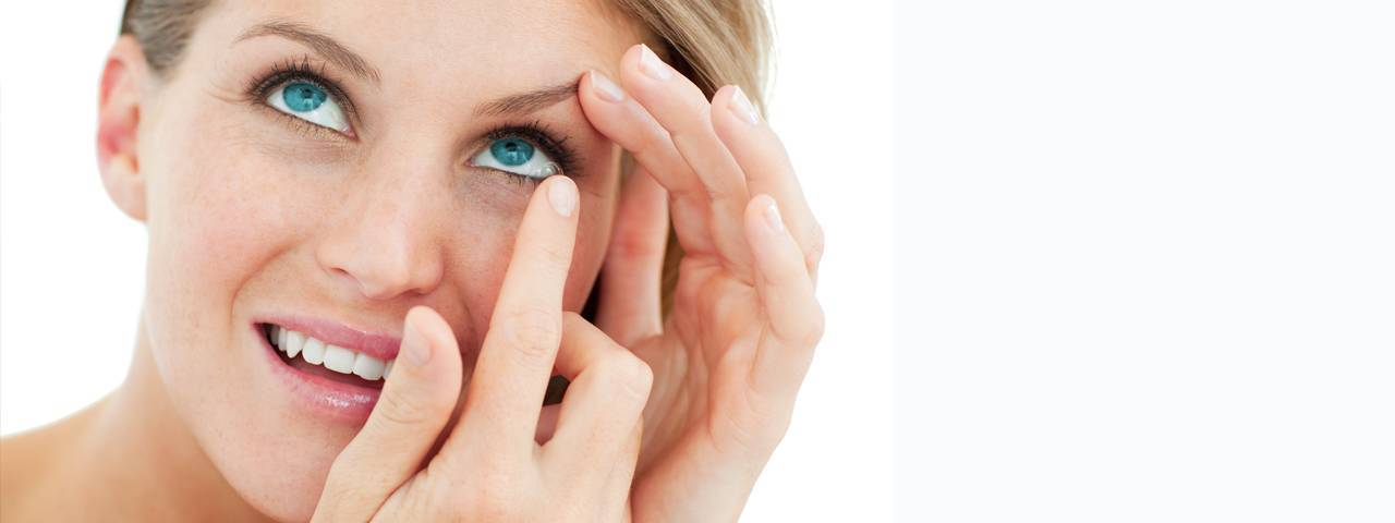 Eye care, woman putting on a contact lens in North Vancouver, BC