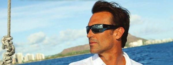 Eye doctor, man wearing Maui Jim sunglasse sin Lantana, FL