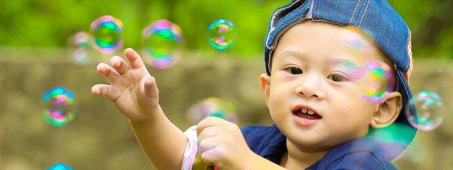 Eye care, baby boy playing with soap bubbles in Providence, RI