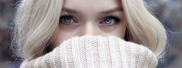 Eye care, blue eyed woman wearing toric contact lenses in Providence RI