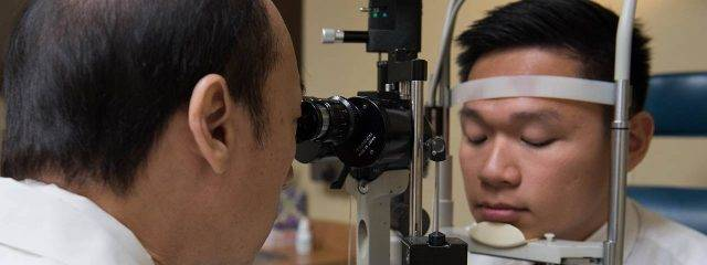 Eye care, woman at an eye exam in Providence, RI
