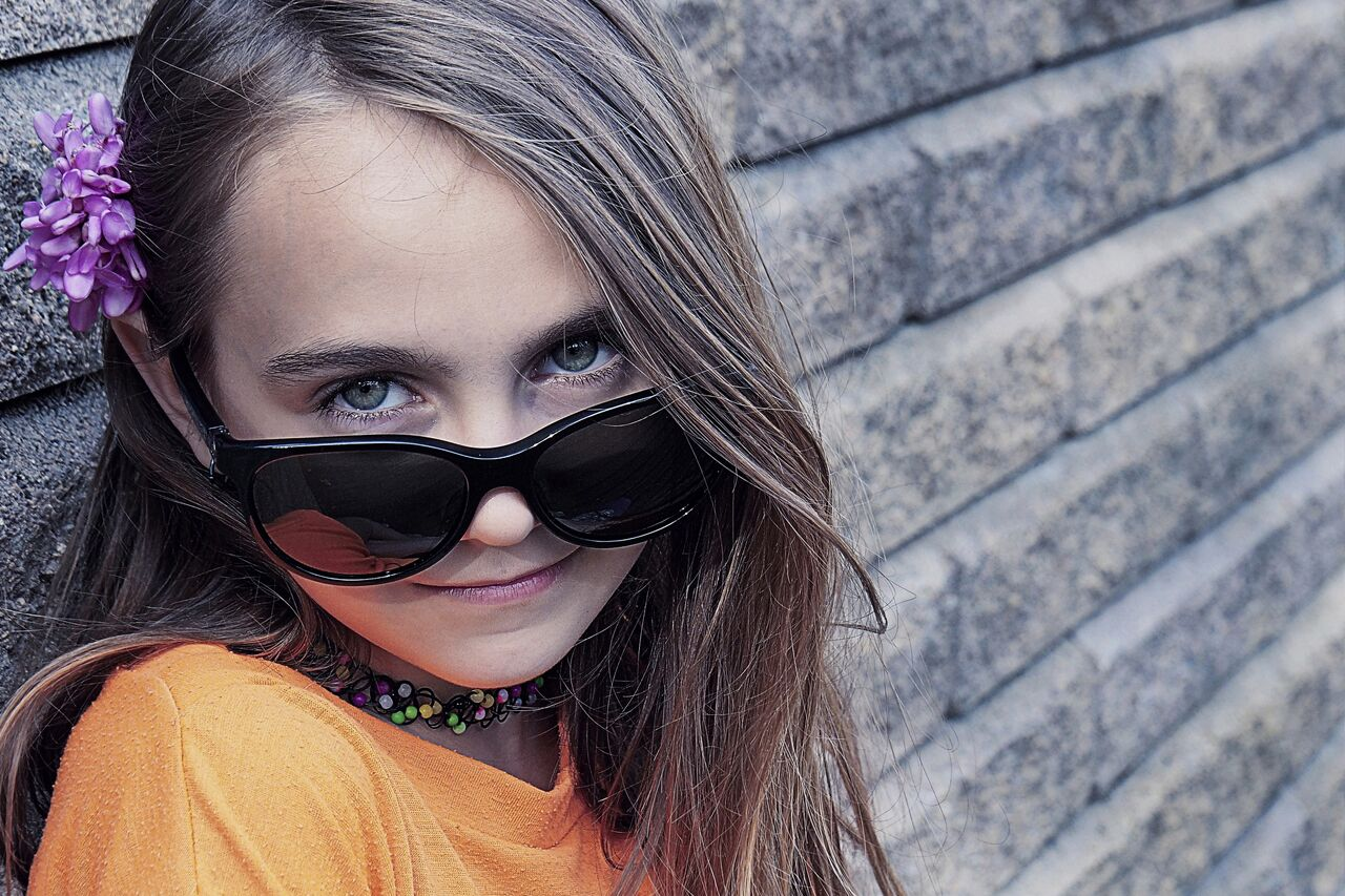 eye doctor, girl wearing sunglasses after orthokeratology in Waterloo, ON