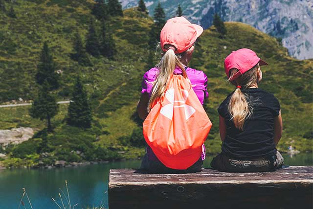 Sisters, resting on a hike, wearing contacts in Waterloo, ON