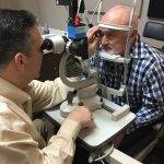 dr august wallace eye exam with patient 1