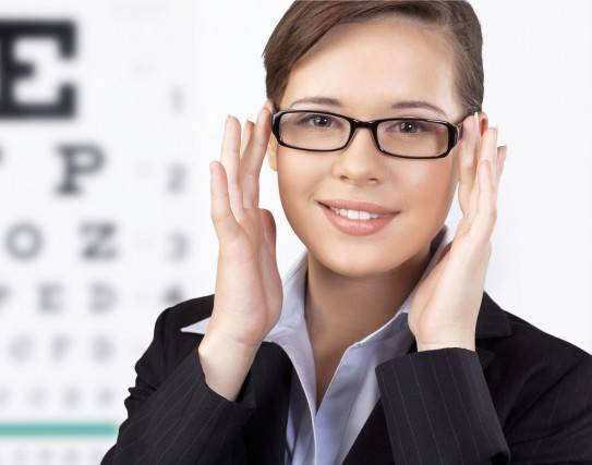 Eye chart with a girl wearing glasses
