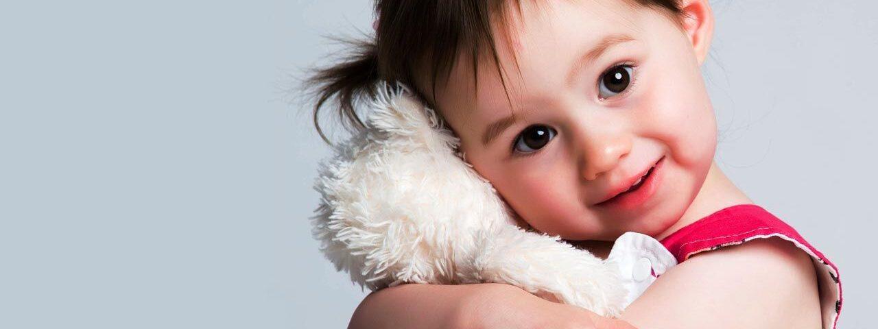 Optometrist little girl hugging teddy in Longview, TX