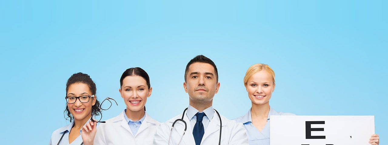 Eye care group of doctors with eye chart and glasses in Longview, TX