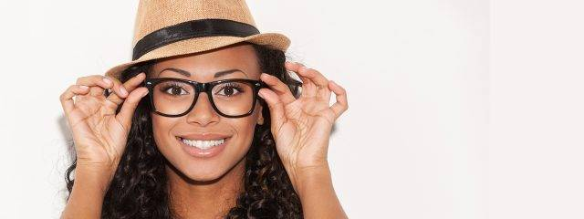 Eye doctor, african american woman wearing designer eyeglasses in Alpha, NJ