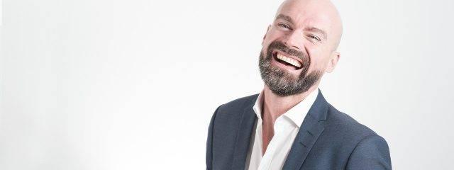 Eye doctor, middle aged man smiling in Alpha, NJ