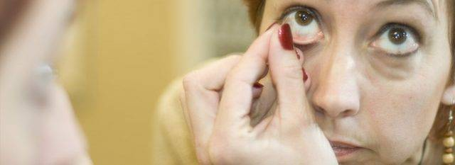 Eye doctor, woman putting on a scleral contact lens in Alpha, NJ