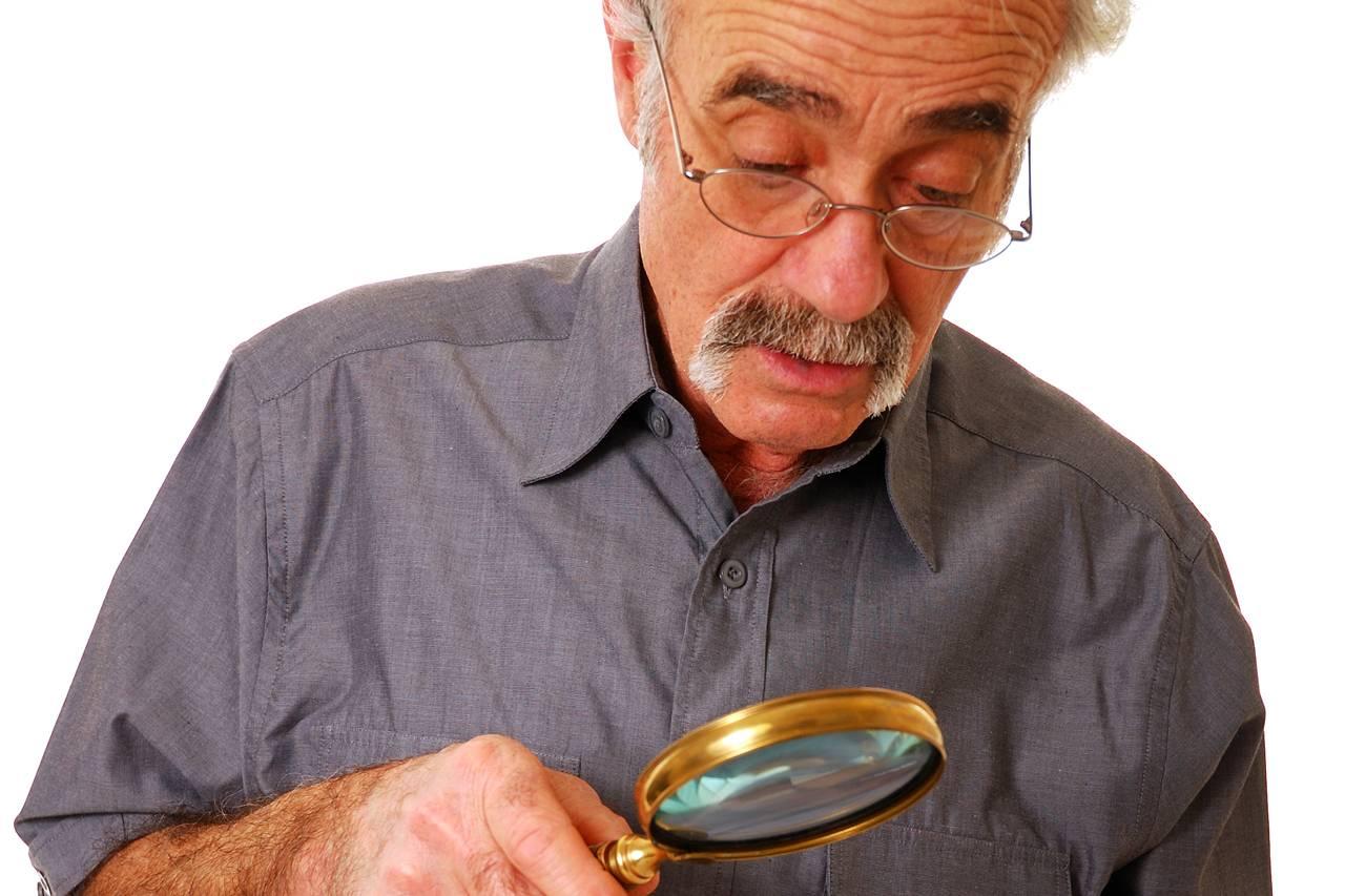 Senior Man Magnifying Glass