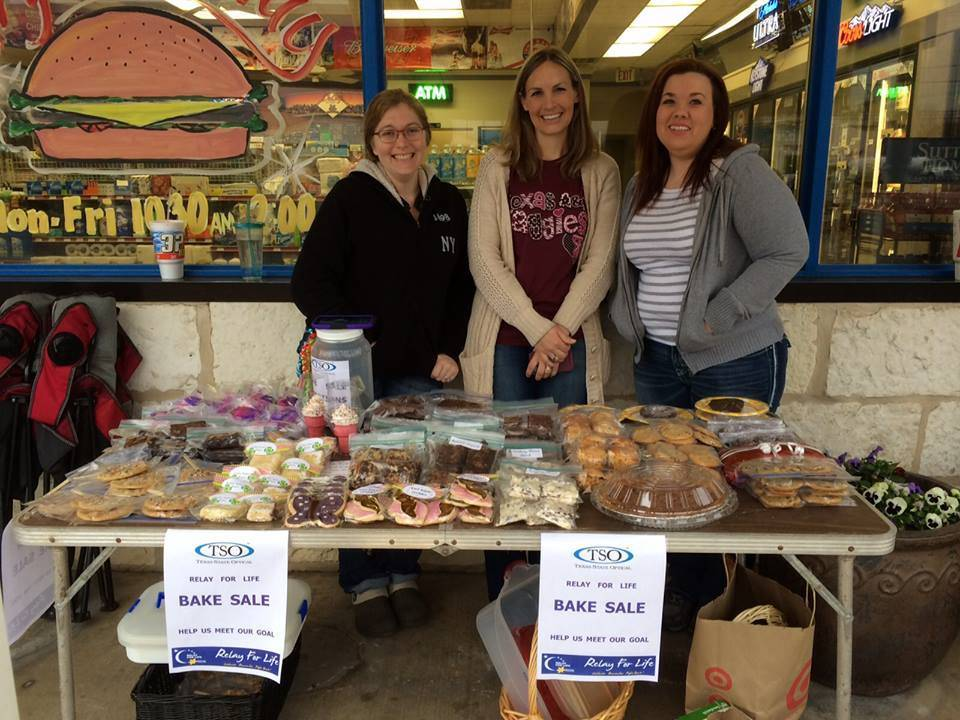 dra and girls at bakesale