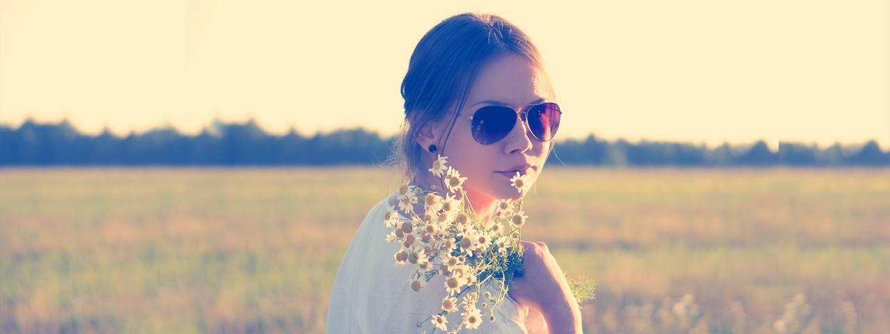 Woman wearing sunglasses in the field in Seattle, WA