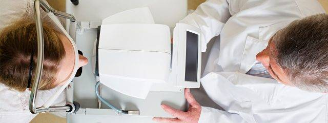 Optometrist, woman at an eye exam in El Paso, TX
