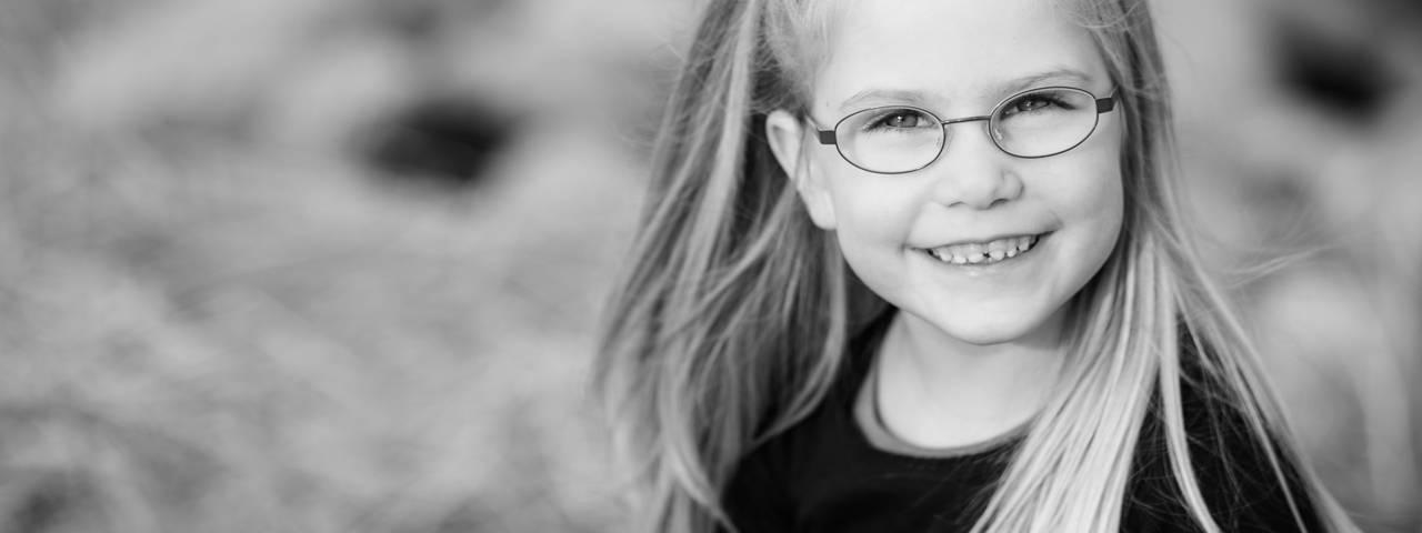 Smiling girl, children's eye exams - Eye doctor in Round Rock, TX