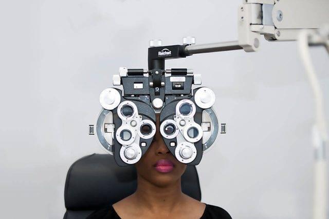 Eye doctor, woman at an eye exam in Grand Prairie, TX