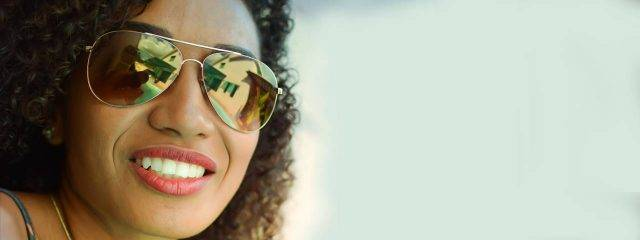 Eye care, woman wearing sunglasses in Irving, TX,