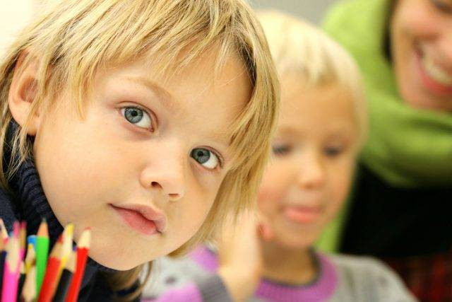 Eye doctor, little boy at school in Sacramento, CA