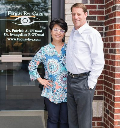 Dr. Angie & Dr. Pat in front of the practice door, Eye Doctor, Fuquay, NC