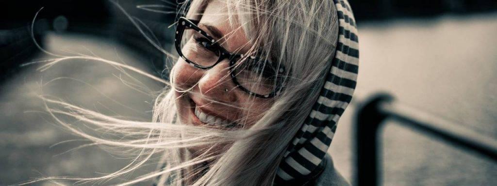 Woman smiling wearing eyeglasses in Irving, TX