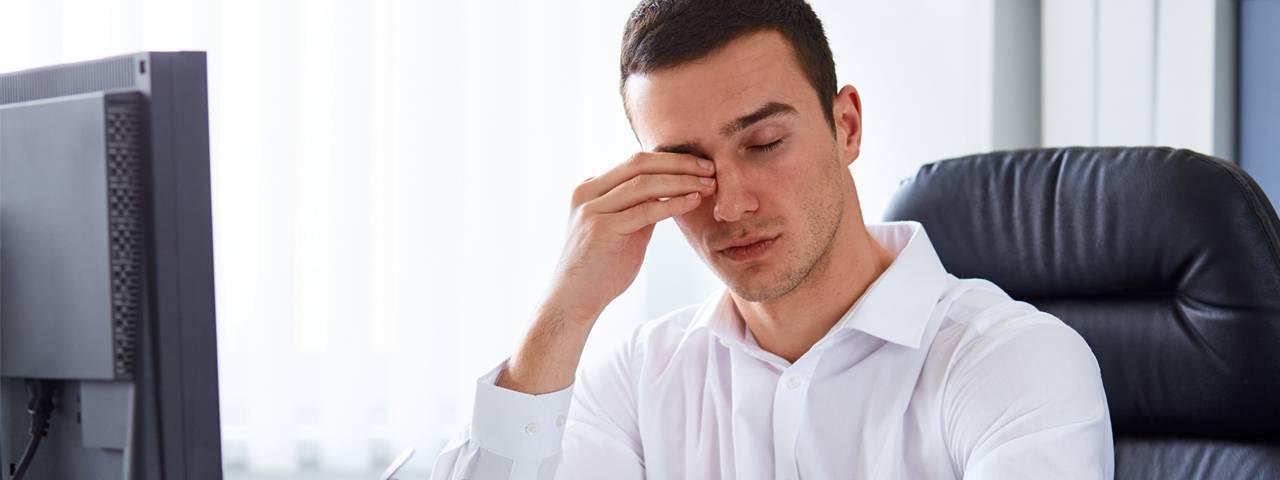 Eye care, man rubbing eyes in Garden Grove, CA