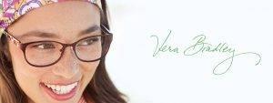 smiling sideways glancing woman in headband wearing Vera Bradley frames